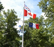 Acadian flag flying at Government House