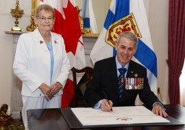 His Honour, accompanied by Her Honour signed a Proclamation of Loyalty at Government House