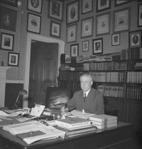The Honourable James Cranswick Tory in the Study of Government House